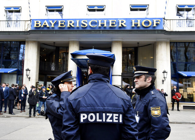 German police officers stand in front of the Bayerischer Hot hotel on the first day of the Munich Security Conference in Munich, Germany, Friday, Feb. 14, 2020. (AP Photo/Jens Meyer)b