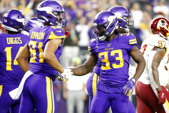 Minnesota Vikings running back Dalvin Cook (33) celebrates after scoring on a 4-yard touchdown run during the first half of an NFL football game against the Washington Redskins, Thursday, Oct. 24, 2019, in Minneapolis. (AP Photo/Bruce Kluckhohn)