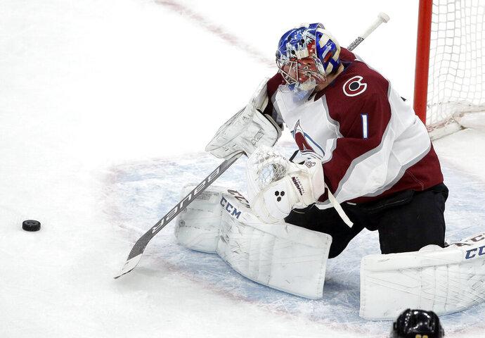 Colorado Avalanche's Semyon Varlamov, of Russia, deflects an attempt on goal during the first period of an NHL hockey game against the Boston Bruins, Sunday, Feb. 10, 2019, in Boston. (AP Photo/Steven Senne)