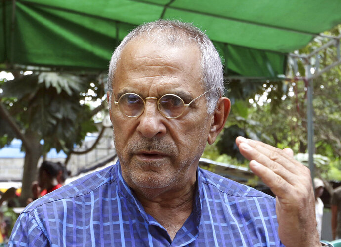 In this Saturday, April 14, 2018, photo, Nobel peace prize laureate and former East Timorese President Jose Ramos-Horta talks to journalists in Dili, East Timor. Ramos-Horta waded back into the young country's politics ahead of parliamentary elections next month, calling the government a total failure in the past decade in crucial areas such as reducing child malnutrition and providing clean water. (AP Photo/Kandhi Barnez)