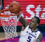 Kansas State guard Barry Brown Jr. dunks during the second half of the team's NCAA college basketball game against Kansas in Manhattan, Kan., Tuesday, Feb. 5, 2019. Brown scored 18 points as Kansas State won 74-67. (AP Photo/Orlin Wagner)