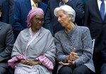 International Monetary Fund (IMF) Managing Director Christine Lagarde speaks with Nigeria's Finance Minister Zainab Ahmed, during the International Monetary Fund IMF Governors group photo at the World Bank/IMF Spring Meetings in Washington, Saturday, April 13, 2019. (AP Photo/Jose Luis Magana)