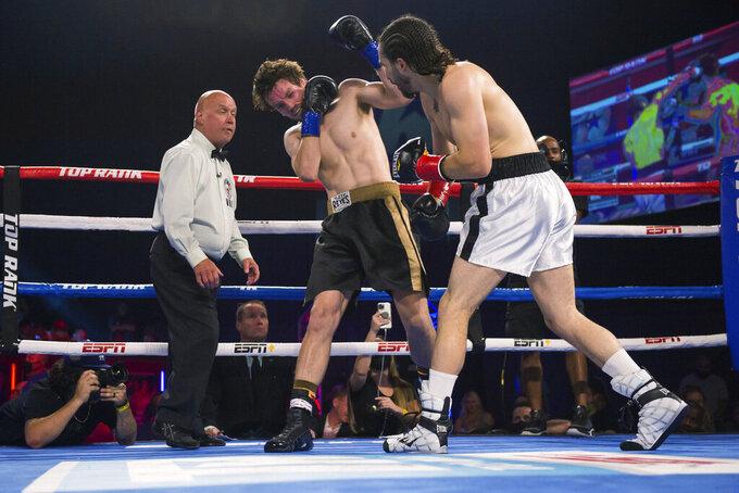 Nico Ali Walsh, right, fights Jordan Weeks during a middleweight boxing bout Saturday, Aug. 14, 2021, near Tulsa, Okla. (Brett Rojo/Tulsa World via AP)
