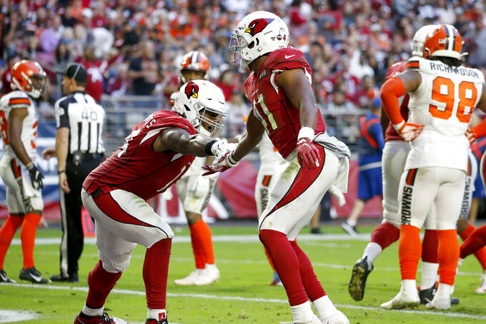 Arizona Cardinals running back Kenyan Drake, right, celebrates his touchdown with offensive tackle D.J. Humphries during the second half of an NFL football game against the Cleveland Browns, Sunday, Dec. 15, 2019, in Glendale, Ariz. (AP Photo/Ross D. Franklin)
