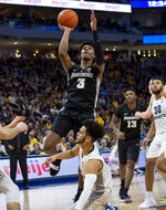 Providence guard David Duke, center, goes up for a basket against Marquette during the second half of an NCAA college basketball game Sunday, Jan. 20, 2019, in Milwaukee. (AP Photo/Darren Hauck)
