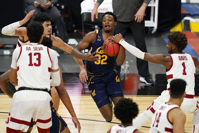 Stanford's Daejon Davis (1) fouls California's Jalen Celestine (32) during the first half of an NCAA college basketball game in the first round of the Pac-12 men's tournament Wednesday, March 10, 2021, in Las Vegas. (AP Photo/John Locher)