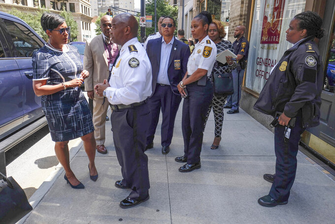 """Atlanta Mayor Keisha Lance Bottoms, left, with Atlanta Police Chief Rodney Bryant, said two officers were """"ambushed"""" while responding to a report of a shooting in a building in the city's Midtown area in Atlanta, Wednesday, June 30, 2021. The officers returned fire, killing one suspect, police said. (Ben Gray/Atlanta Journal-Constitution via AP)"""