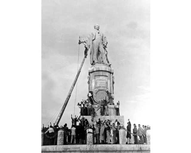 "FILE - In this Dec. 24, 1956 file photo, Egyptian civilians climb on the statue of Ferdinand de Lesseps, the French diplomat who was behind the construction of Egypt's Suez Canal, in Port Said, prior to blowing it up. A proposal to bring back the statue has stirred controversy in Egypt with many saying it would be a salute to colonial times and a ""humiliation"