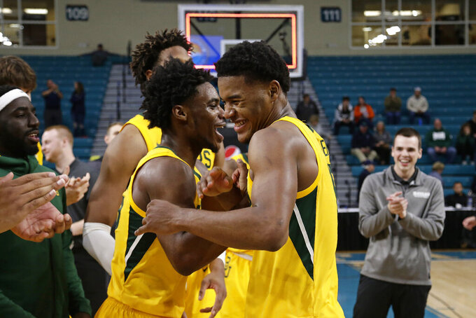 Baylor guard Davion Mitchell, left, and most valuable player, guard Jared Butler celebrate following an NCAA college basketball championship game against Villanova at the Myrtle Beach Invitational in Conway, S.C., Sunday, Nov. 24, 2019. Baylor won 87-78. (AP Photo/Gerry Broome)