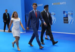 Canadian Prime Minister Justin Trudeau, center, arrives for a summit of heads of state and government at NATO headquarters in Brussels on Wednesday, July 11, 2018. NATO leaders gather in Brussels for a two-day summit to discuss Russia, Iraq and their mission in Afghanistan. (AP Photo/Francois Mori)