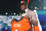 Alabama cornerback Patrick Surtain II holds a team jersey after he was chosen by the Denver Broncos with the ninth pick in the NFL football draft Thursday, April 29, 2021, in Cleveland. (AP Photo/Tony Dejak)