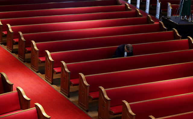 A man prays while attending an Easter service at Trinity Baptist Church in San Antonio, Sunday, April 12, 2020. Many churches are adapting their services as Christians around the world are celebrating Easter at a distance due to the COVID-19 pandemic. (AP Photo/Eric Gay)