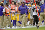 LSU coach Ed Orgeron walks on the sidelines against Arkansas during the second half of an NCAA college football game Saturday, Nov. 21, 2020, in Fayetteville, Ark. (AP Photo/Michael Woods)