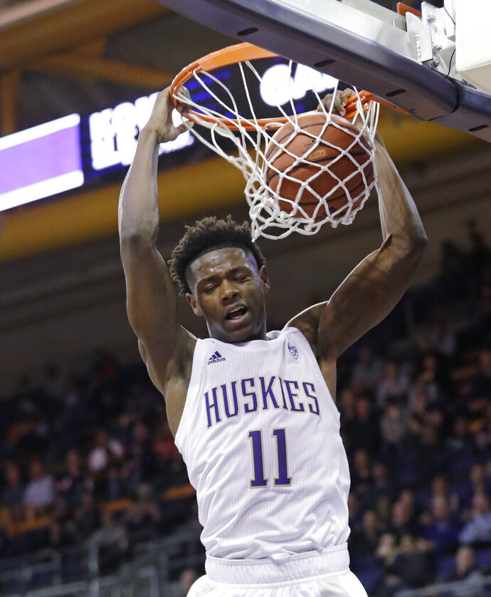 Washington's Nahziah Carter dunks against Maine during the second half of an NCAA college basketball game Tuesday, Nov. 19, 2019, in Seattle. (AP Photo/Elaine Thompson)