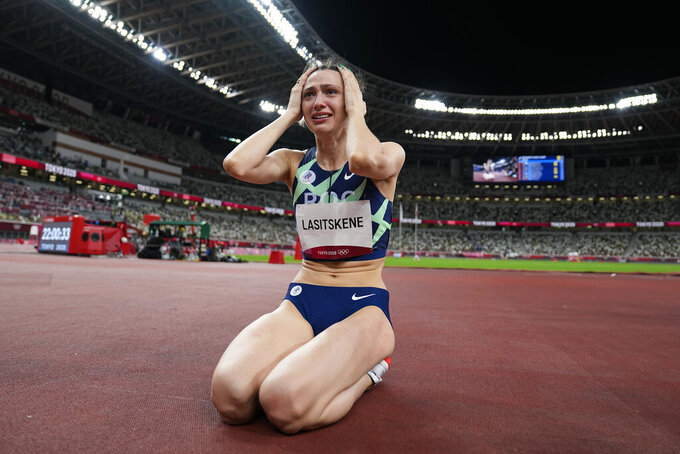 Mariya Lasitskene, of Russian Olympic Committee, celebrates after winning the gold medal in the women's high jump final at the 2020 Summer Olympics, Saturday, Aug. 7, 2021, in Tokyo. (AP Photo/David J. Phillip)