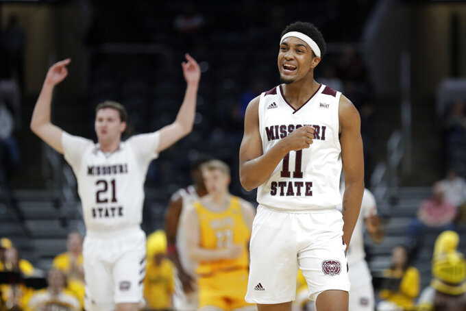Missouri State's Isiaih Mosley and Ross Owens (21) celebrate during the first half of an NCAA college basketball game against Valparaiso in the semifinal round of the Missouri Valley Conference men's tournament Saturday, March 7, 2020, in St. Louis. (AP Photo/Jeff Roberson)