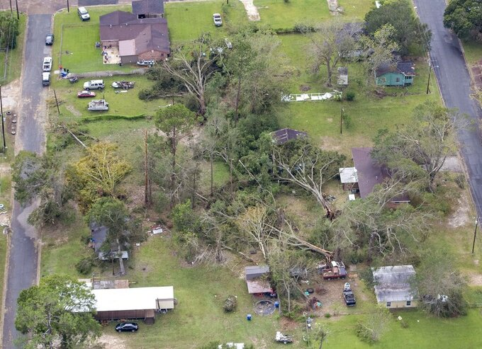 FILE - In this Aug. 28, 2020, file photo, fallen trees and damaged roofs are left in the aftermath of Hurricane Laura, in DeRidder, La., as seen during Gov. John Bel Edwards' aerial tour of stricken areas in the northern part of the state. (Bill Feig/The Advocate via AP, Pool, File)