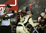 Tyler Reddick, right, sprays champagne after winning the NASCAR Xfinity Series championship auto race at the Homestead-Miami Speedway, Saturday, Nov. 17, 2018, in Homestead, Fla. (AP Photo/Terry Renna)
