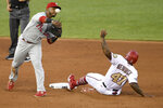 Washington Nationals' Howie Kendrick (47) is out at second as Philadelphia Phillies second baseman Jean Segura throws to first but is unable to put out Nationals' Luis Garcia during the fourth inning of a baseball game Wednesday, Aug. 26, 2020, in Washington. (AP Photo/Nick Wass)