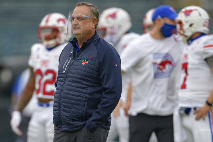 SMU head coach Sonny Dykes watches his team during an NCAA college football game against Tulane in New Orleans, Friday, Oct. 16, 2020. (AP Photo/Matthew Hinton)