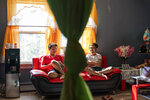 Bawi UK, 22, right, chats with his brother, Leng Nung, 20, in the apartment they share in Providence, R.I., Saturday, Sept. 26, 2020. UK was a small child when his parents fled Myanmar, leaving him and his siblings to be cared for by their maternal grandmother. UK said the family suffered discrimination as Christians in a predominantly Buddhist nation. The military government was also trying to forcibly conscript his father.