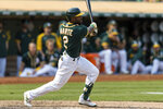 Oakland Athletics' Starling Marte hits an RBI for a walk-off win against the Houston Astros in the ninth inning of a baseball game in Oakland, Calif., Saturday, Sept. 25, 2021. The Athletics won 2-1. (AP Photo/John Hefti)