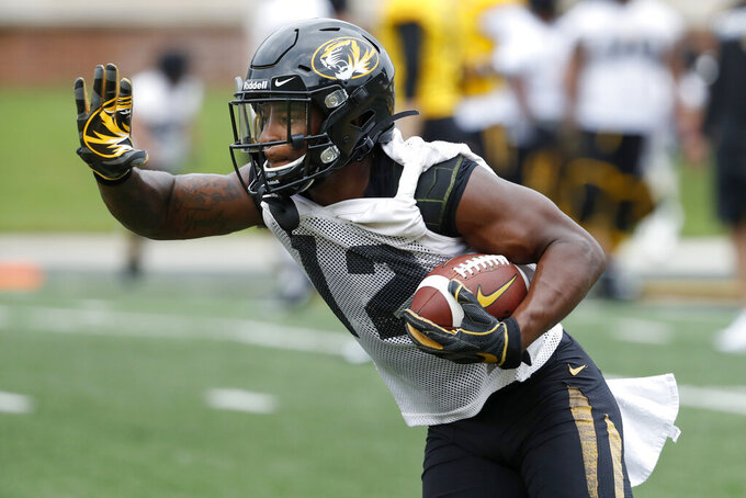Missouri wide reciever Johnathon Johnson runs with the ball during an NCAA college football practice Monday, Aug. 12, 2019, in Columbia, Mo. (AP Photo/Jeff Roberson)