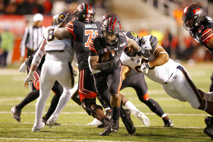 Utah running back Zack Moss (2) breaks free from a tackle of California nose tackle Luc Bequette (93) in the second half in an NCAA college football game Saturday, Oct. 26, 2019, in Salt Lake City. (AP Photo/Rick Bowmer)