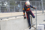Red Bull driver Max Verstappen of the Netherlands climbs through a fence after crashing out during the Formula One Grand Prix at the Baku Formula One city circuit in Baku, Azerbaijan, Sunday, June 6, 2021. (Maxim Shemetov, Pool via AP)