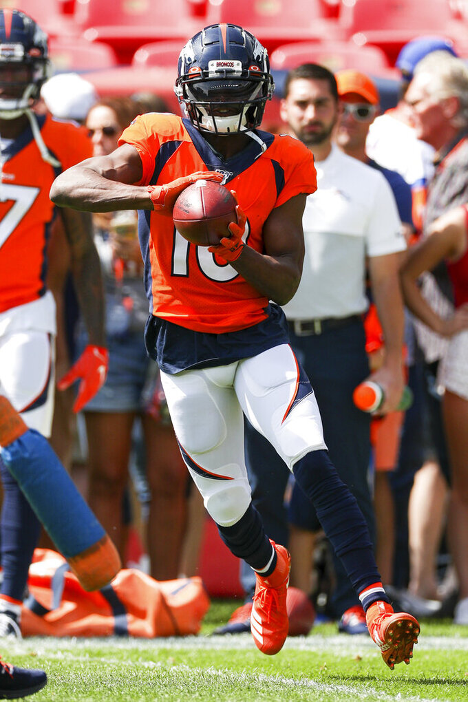 Denver Broncos wide receiver Emmanuel Sanders (10) catches a pass during warm-ups prior to an NFL game against the Chicago Bears, Sunday Sept. 15, 2019, in Denver. The Bears defeated the Broncos 16-14. (Margaret Bowles via AP)