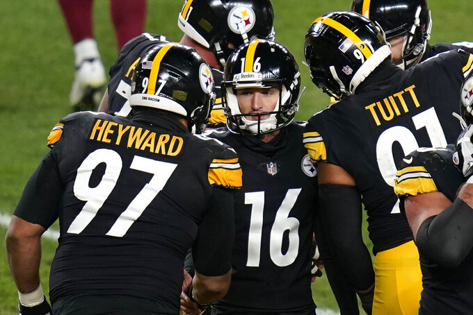 Pittsburgh Steelers place kicker Matthew Wright (16) celebrates with teammates after making an extra point during the first half of an NFL football game against the Washington Football Team, Monday, Dec. 7, 2020, in Pittsburgh. (AP Photo/Keith Srakocic)