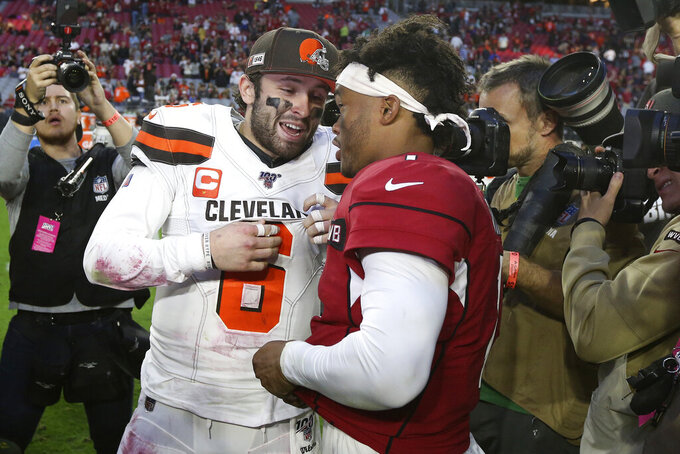 Arizona Cardinals quarterback Kyler Murray, right, greets Cleveland Browns quarterback Baker Mayfield (6) after an NFL football game, Sunday, Dec. 15, 2019, in Glendale, Ariz. The Cardinals won 38-24. (AP Photo/Ross D. Franklin)