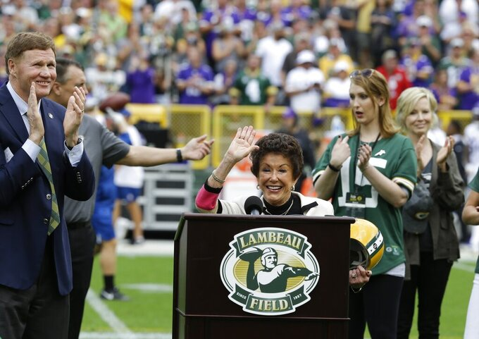 Cherry Louise Morton, wife of former Green Bay Packers Bart Starr waves during halftime of an NFL football game against the Minnesota Vikings Sunday, Sept. 15, 2019, in Green Bay, Wis. (AP Photo/Mike Roemer)