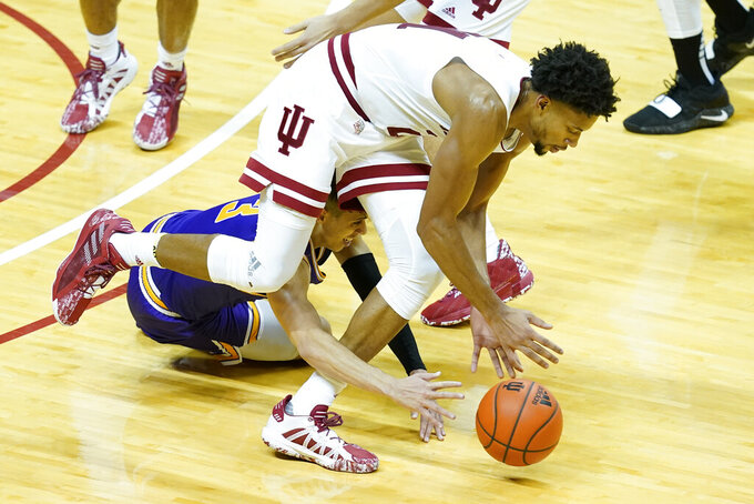 Indiana's Jerome Hunter (21) controls a loose ball against Tennessee Tech's Keishawn Davidson (3) during the second half of an NCAA college basketball game, Wednesday, Nov. 25, 2020, in Bloomington, Ind. (AP Photo/Darron Cummings)