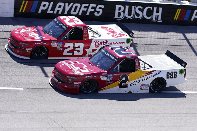 Sheldon Creed (2) and Brett Moffitt (23) vie for a spot on the track during a NASCAR Truck race Sunday, Sept. 6, 2020, in Darlington, S.C. (AP Photo/Chris Carlson)