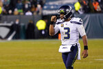 Seattle Seahawks' Russell Wilson reacts during the second half of an NFL wild-card playoff football game against the Philadelphia Eagles, Sunday, Jan. 5, 2020, in Philadelphia. (AP Photo/Chris Szagola)