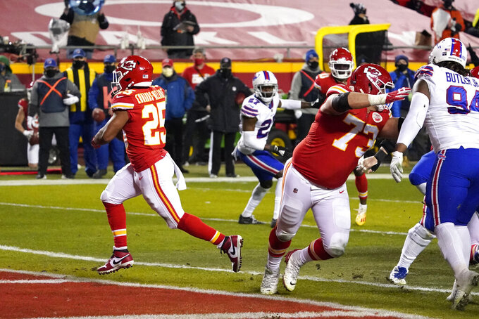 Kansas City Chiefs running back Clyde Edwards-Helaire (25) scores on a 1-yard touchdown run during the first half of the AFC championship NFL football game against the Buffalo Bills, Sunday, Jan. 24, 2021, in Kansas City, Mo. (AP Photo/Jeff Roberson)