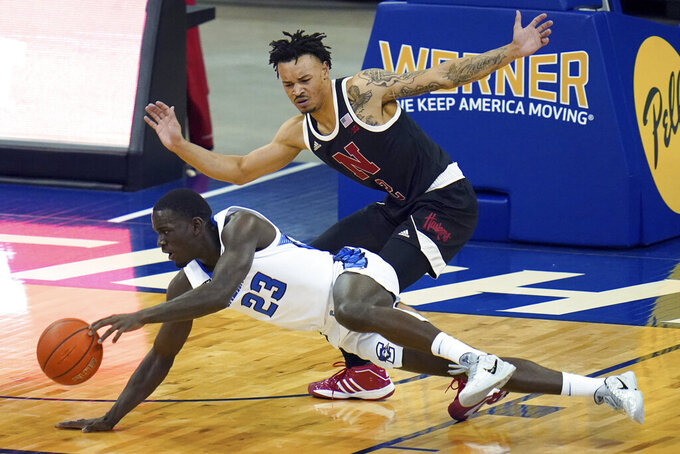 Creighton's Damien Jefferson (23) slips as he drives around Nebraska's Trey McGowens (2) during the first half of an NCAA college basketball game in Omaha, Neb., Friday, Dec. 11, 2020. (AP Photo/Nati Harnik)