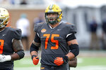 FILE - National Team offensive lineman Dillon Radunz of North Dakota State is shown during the second half of the NCAA college football Senior Bowl in Mobile, Ala, in this Saturday, Jan. 30, 2021, file photo. There's a common thread linking most of the Football Championship Subdivision players who expect to hear their name called in this month's NFL draft. They didn't participate in their schools' pandemic-delayed spring season. (AP Photo/Rusty Costanza, File)