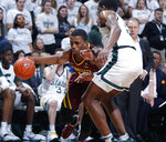 Minnesota's Isaiah Washingotn, left, drives against Michigan State's Aaron Henry during the first half of an NCAA college basketball game, Saturday, Feb. 9, 2019, in East Lansing, Mich. (AP Photo/Al Goldis)