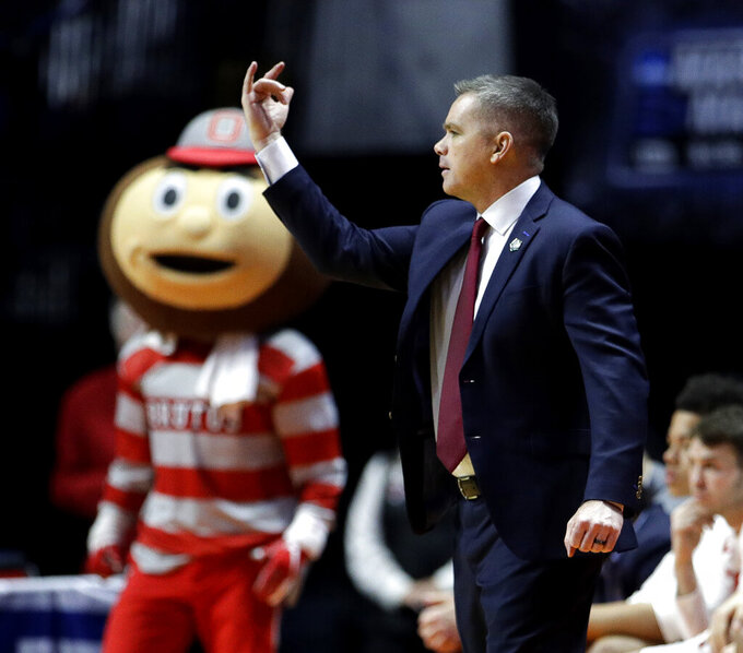 Ohio State head coach Chris Holtmann motions to his players during the second half of a first round men's college basketball game against Iowa State in the NCAA Tournament Friday, March 22, 2019, in Tulsa, Okla. Ohio State won 62-59. (AP Photo/Charlie Riedel)