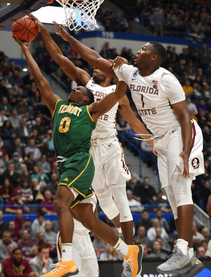 Kabengele, Mann lead 4th-seed FSU over hot-shooting Vermont