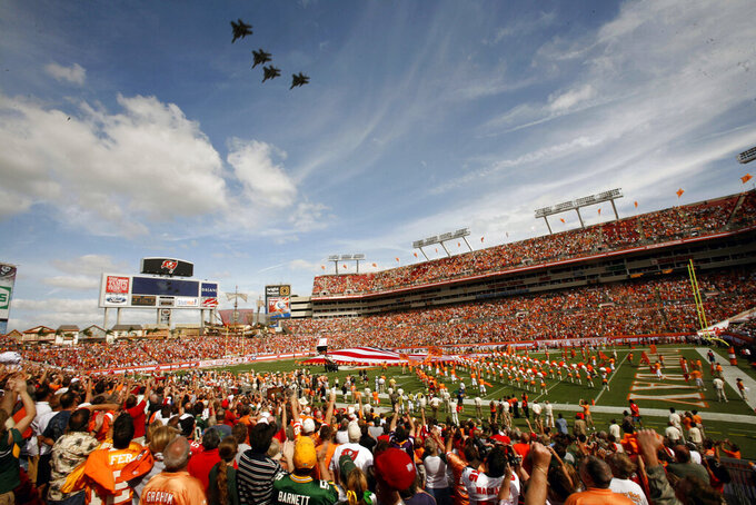 FILE - Tampa Bay Buccaneers fans cheer during a military fly over before an NFL football game against the Green Bay Packers  in Tampa, in this Sunday, Nov. 8, 2009, file photo. Hall of Famer Warren Sapp wishes the Tampa Bay Buccaneers could pack the stands for the first Super Bowl played in a host team's home stadium. (AP Photo/Brian Blanco, File)