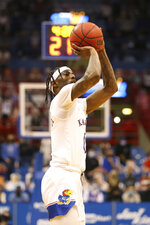 Kansas guard Marcus Garrett shoots a 3-pointer during the second half of the team's NCAA college basketball game against West Virginia on Tuesday, Dec. 22, 2020, in Lawrence, Kan. (Evert Nelson/The Topeka Capital-Journal via AP)