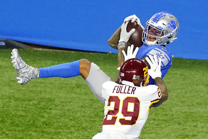 Detroit Lions wide receiver Marvin Jones (11), defended by Washington Football Team cornerback Kendall Fuller (29), catches a 27-yard pass for a touchdown during the first half of an NFL football game, Sunday, Nov. 15, 2020, in Detroit. (AP Photo/Carlos Osorio)