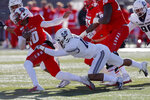 New Mexico quarterback Trae Hall (10) is sacked by Utah State defensive end Tipa Galeai during the first half of an NCAA college football game on Saturday, Nov. 30, 2019 in Albuquerque, N.M. (AP Photo/Andres Leighton)