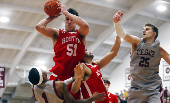 Boston University's Max Mahoney (51) grabs a rebound over Colgate's Jordan Burns (1) in the second half of the NCAA Patriot League Conference basketball championship at Cotterell Court, Wednesday, March 11, 2020, in Hamilton, N.Y. (AP Photo/John Munson)