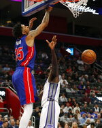Detroit Pistons forward Christian Wood (35) dunks on Sacramento Kings center Dewayne Dedmon during the first half of an NBA basketball game, Wednesday, Jan. 22, 2020, in Detroit. (AP Photo/Carlos Osorio)