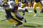 Las Vegas Raiders wide receiver Hunter Renfrow (13) is tackled by Pittsburgh Steelers cornerback Justin Layne (31) during the first half of an NFL football game in Pittsburgh, Sunday, Sept. 19, 2021. (AP Photo/Don Wright)