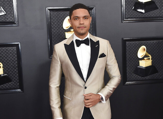 FILE - Trevor Noah arrives at the 62nd annual Grammy Awards in Los Angeles on Jan. 26, 2020. Noah has been tapped to host the 2021 Grammy Awards. The Recording Academy made the announcement hours before the nominees for the 2021 show would be revealed. It would mark Noah's first time hosting the Grammys. (Photo by Jordan Strauss/Invision/AP, File)